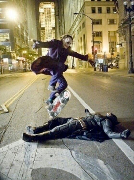 joker kick flipping skateboard